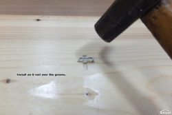Install an U nail over the groove.