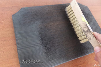 Clean off all the brittle charcoal with a wire brush.