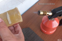 Melt a bit of beeswax over the torch