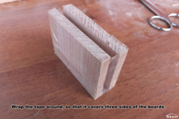 Wrap the tape around, so that it covers three sides of the boards.